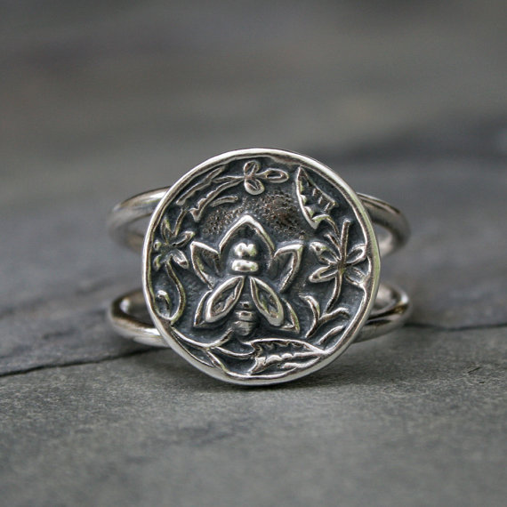 Flower Garden Bee Ring--bu Kira Ferrer.  I have a pair of earrings from this shop that I wear at least 4 days a week--beautiful craftmanship, and a fabulous shop!