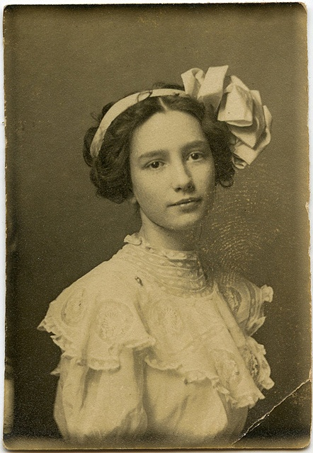 Vintage young woman--she manages to make that gigantic bow look perfect